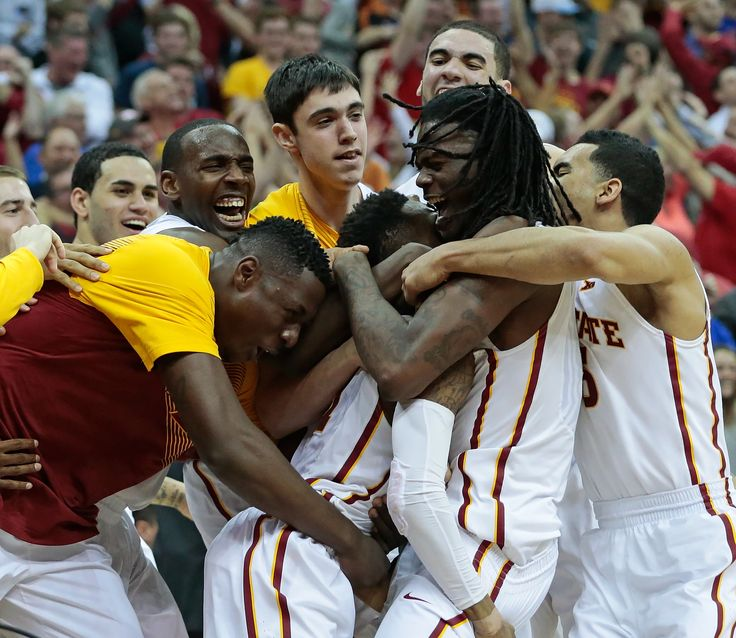 The Iowa State basketball team swarms guard Monte Morris after Morris made the game-winning shot as time expired to beat Texas in the quarterfinals of the Big 12 Tournament on Thursday in Kansas City, Mo. Photo by Brian Achenbach/Special to the Ames Tribune.