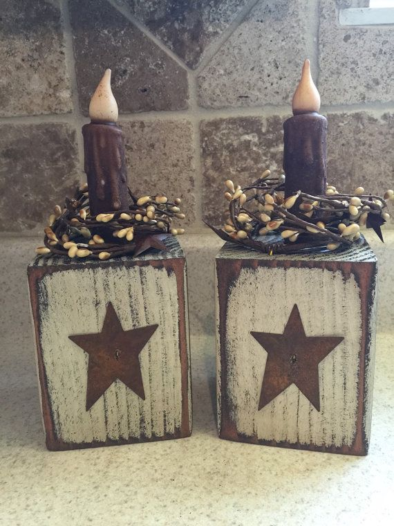 Primitive Candle Block with Rusty Tin Star and pip berry candle ring:  They are decorated with a cream pip berry candle ring, rusty tin star and 4 cinnamon rolled brown LED wax candle (CANDLE REQUIRES 1AA BATTERY) battery is NOT INCLUDED.  Dimensions: The block is approximately 3 1/2 inches high by 3 1/2 inches in depth, with candle the height is approximately 9.  We test all our candles before shipping, so we know youre getting a working candle…