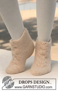 """Free pattern: DROPS felted slippers with cable pattern in """"Nepal"""". ~ Cozy felted slippers. Warmer than just knitted ones."""