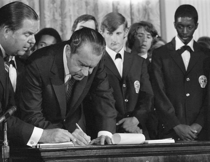 June 22,  1970: PRESIDENT NIXON SIGNS 26TH AMENDMENT (VOTING AGE LOWERED TO 18)  -   President Nixon affixes his signature to signify that he witness to the certification of ratification of the 26th amendment of the Constitution of the U.S. 7/5 which gives 18-year-olds the right to vote.