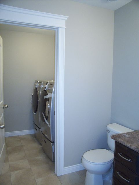 bathroom and laundry room combinations | 56 Bayview Heights SOLD - Square Line Builders Inc.