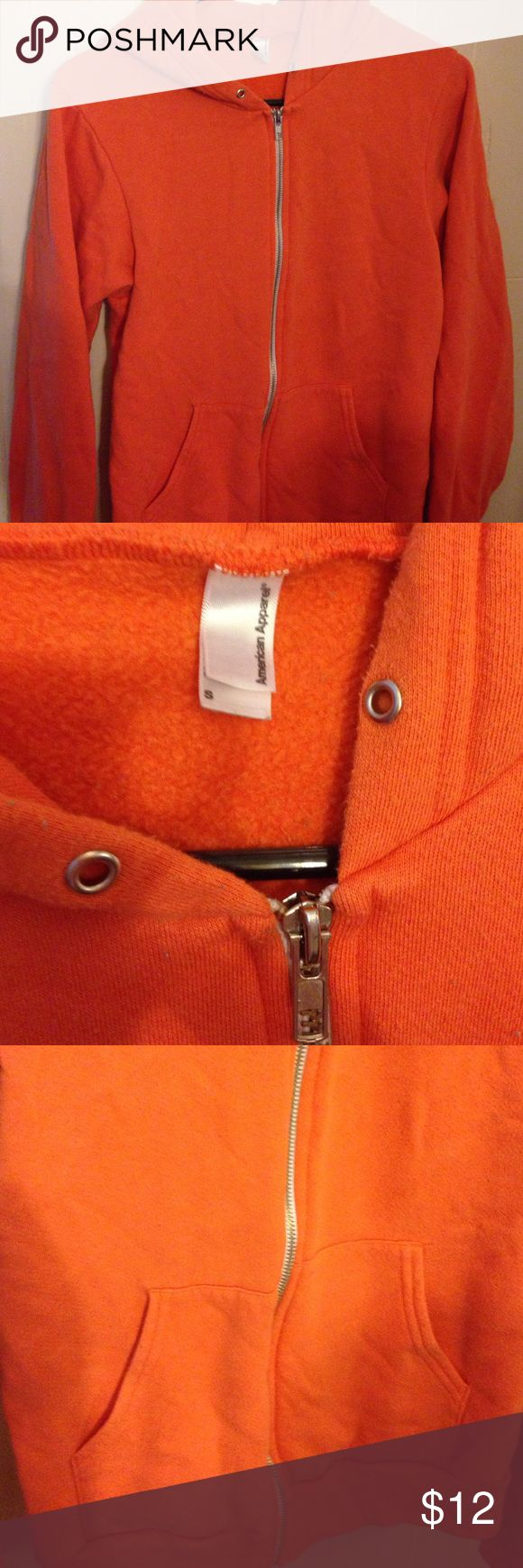 american apparel orange hoodie small no strings One of the best sellers from American Apparel, ORANGE zip up hoodie (strings are gone) very warm cute and comfortable. 50% cotton 50% polyester. American Apparel Jackets & Coats