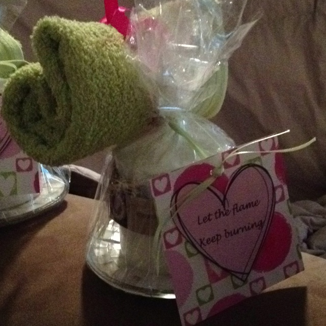 bridal shower prizebath towel and candle on a candle holder plate