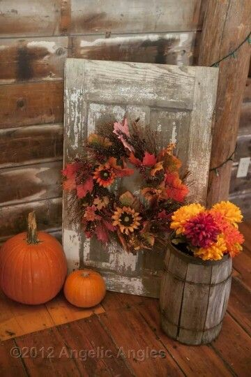 Autumn Wreath Attached To Old Wood.
