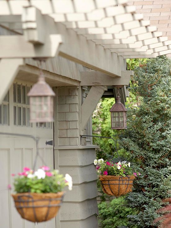 Dress Up Your Garage with an arbor, lanterns and hanging baskets