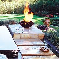 An outdoor fireplace can add the finishing touch to your backyard hot tub or spa.  http://www.outdoorlivingideas.com/outdoor_fireplaces/fireplaces_nature.html
