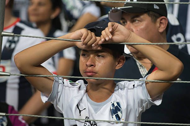 A boy fan of Monterrey cries after their loss to Pachuca
