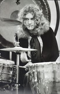 Robert Plant behind the drums.