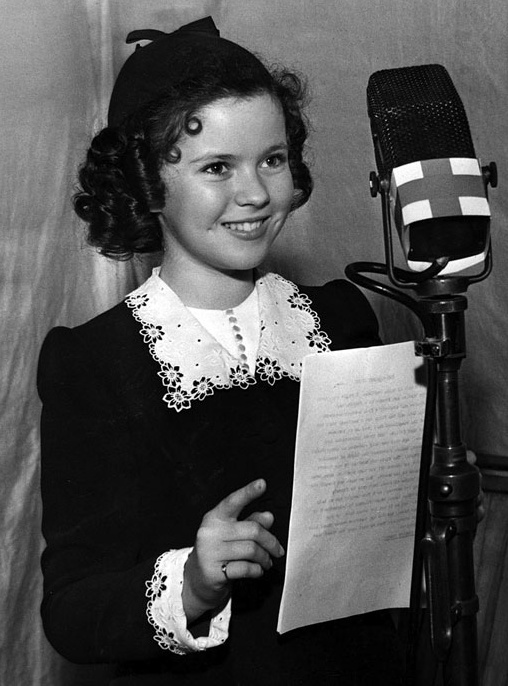 Shirley Temple appears at a two-hour nationwide radio benefit for the American Red Cross Mercy Fund on June 22, 1940.