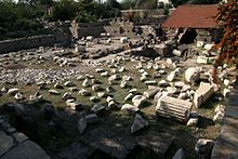 The site of the Mausoleum lies in ruins today.  The Mausoleum at Halicarnassus or Tomb of Mausolus (Turkish: Halikarnas Mozolesi, Greek: Μαυσωλείο της Αλικαρνασσού) was a tomb built between 353 and 350 BC at Halicarnassus (present Bodrum, Turkey) for Mausolus, a satrap in the Persian Empire, and Artemisia II of Caria, who was both his wife and his sister. The structure was designed by the Greek architects Satyros and Pythius of Priene.