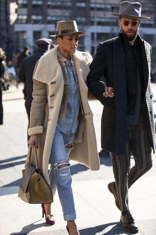 Shop this look on Lookastic:  http://lookastic.com/women/looks/pumps-satchel-bag-boyfriend-jeans-denim-shirt-bomber-jacket-shearling-coat-hat/6846  — Purple Embellished Suede Pumps  — Brown Leather Satchel Bag  — Light Blue Ripped Boyfriend Jeans  — Light Blue Denim Shirt  — Tan Leather Bomber Jacket  — Tan Shearling Coat  — Khaki Wool Hat
