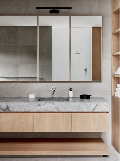 Modern bathroom with concrete, stone and wood.