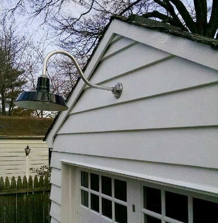 10 best barn lights images on pinterest exterior lighting a black goodrich sky chief porcelain gooseneck light over a beautiful white garage workwithnaturefo