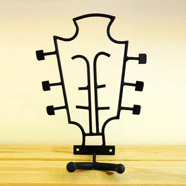 Soporte de Guitarra. Original colgador de pared para guitarra con forma de clavijero. Un objeto único con el que decorar una habitación, es una pieza resiste que aguantará el peso de cualquier guitarra.