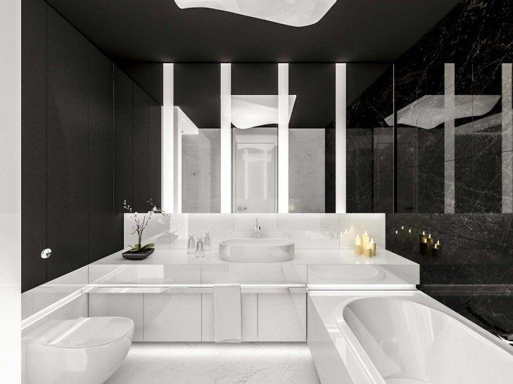 Projekt nowoczesnej łazienki w apartamencie w Warszawie wykończonej białym i czarnym marmurem.  Dolna część łazienki jest w bieli, zaś powyżej króluje czerń.