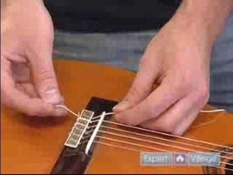 Tips on How to Set Up a Guitar : How to Replace Strings on a Classical Guitar - http://music.onwired.biz/classical-music-videos/tips-on-how-to-set-up-a-guitar-how-to-replace-strings-on-a-classical-guitar/