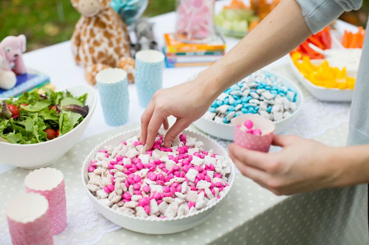 Use Chex cereal, peanut butter, powdered sugar and pink + blue candy to make Pastel Muddy Buddies for your party.