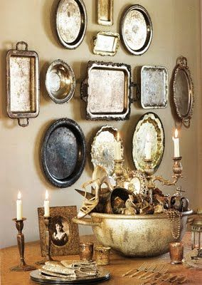 A Pretty Wall Display of Thrift Shop / Second Hand Silver Trays. Looks lovely with photos, candles etc. A lovely statement in any Dining Area.