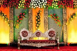 Image result for indian wedding stage for mehendi with flower decoration