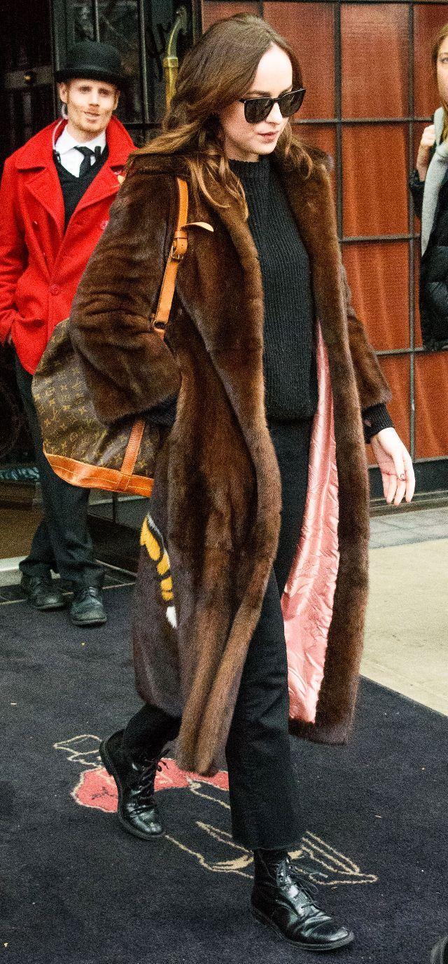 On Dakota Johnson: Saint Laurent sunglasses; Louis Vuitton Noe Bag ($1440); Gucci Tiger Intarsia Mink Coat ($34,000); Mother The Hustler Ankle Fray Jeans ($198).