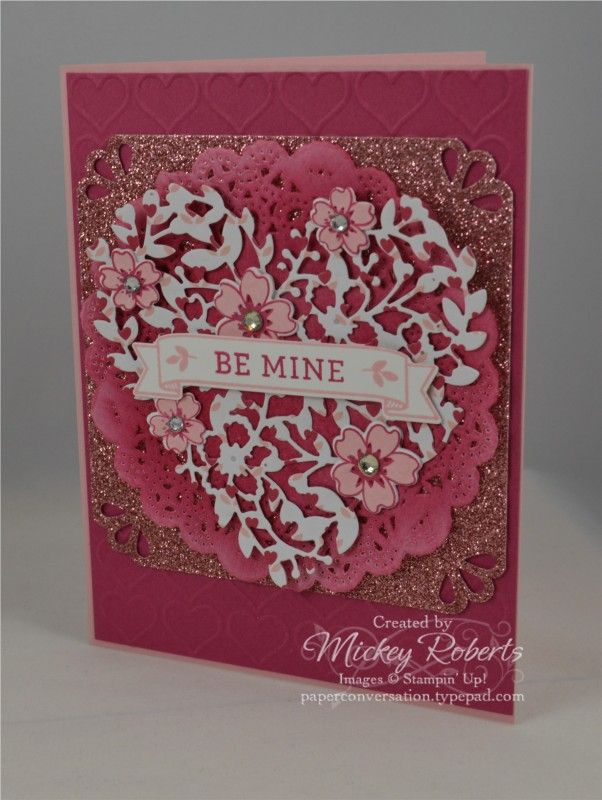 A Valentine's Day card with glimmer and shine.  More information about how this card is made is available on my blog at:  http://paperconversation.typepad.com/paper-conversation/2016/01/bloomin-love-be-mine-valentine.html