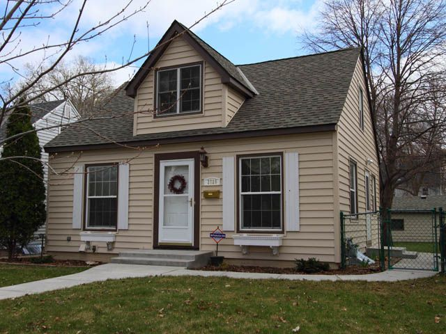 Cape cod style house the typical cape has a central main for Cape cod dormer plans