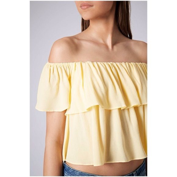 """Topshop off the shoulder yellow crop top Lemon yellow Bardot top in a crinkle viscose. Machine washable. Great condition except for a couple of minor snags on the back (see last pic). Measures 12"""" long. The perfect summer top with the trendy off shoulder look! Topshop Tops Crop Tops"""