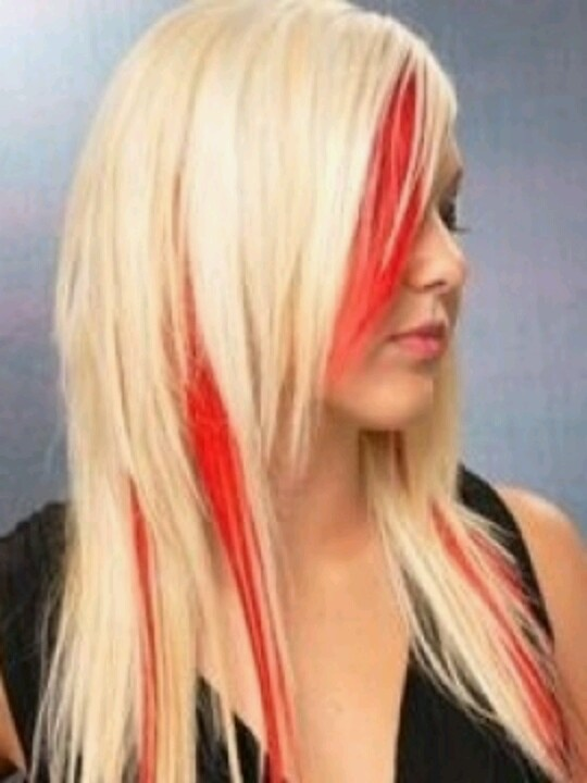 Bright red peek-a-boo highlights, only with brown hair instead of blonde