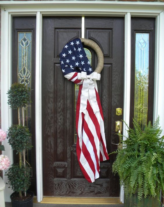 American Flag, Patriotic Wreath with Bow, wreath form is a 18″, jute wrapped, straw wreath