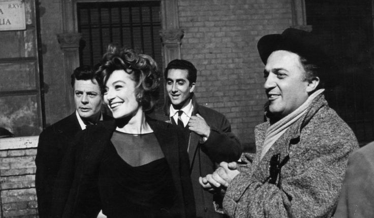 "Marcello Mastroianni, Anouk Aimée and Federico Fellini on the set of ""La Dolce Vita"""