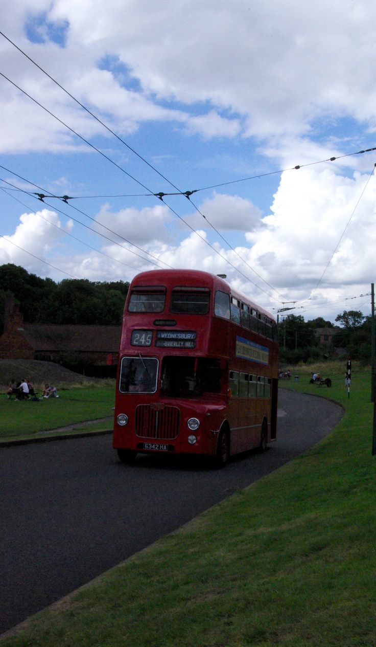An old fashioned red bus at the Black Country Living Museum