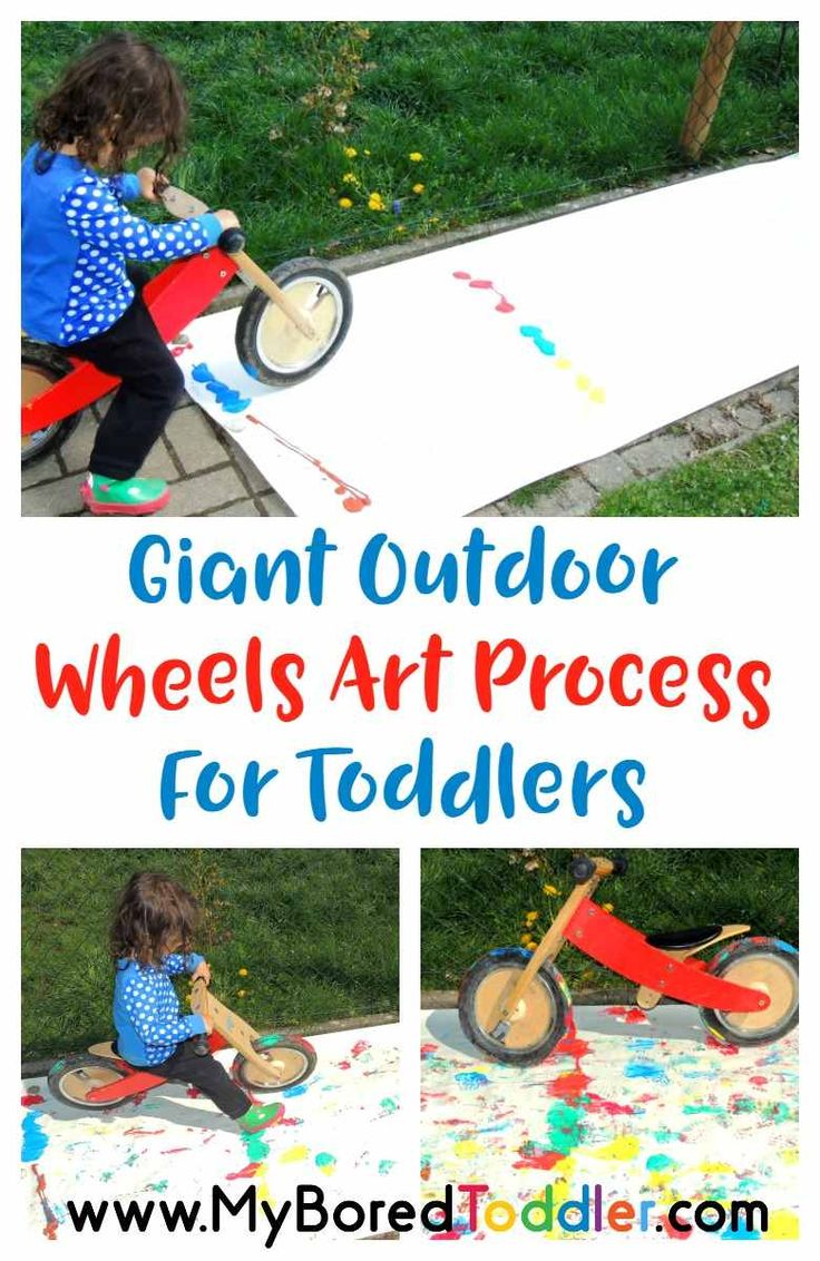 Giant Outdoor Painting for Toddlers. This process art toddler activity is perfect for 1 year olds, 2 year olds and 3 year olds. A great outdoor summer activity for toddlers.