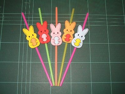straws.  would be cute in glass bottles