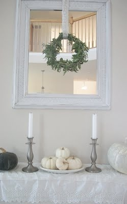 Shabby Chic mirror with natural hanging wreath. Love this idea.
