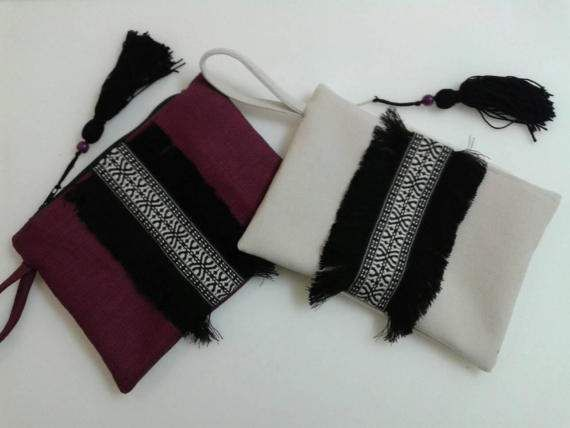 Check out this item in my Etsy shop https://www.etsy.com/listing/518868611/boho-chic-wristlet-clutch-with-fringe