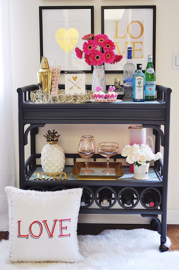 I love decorating the bar cart for Valentine's Day! All these beautiful pink glassware accessories from HomeGoods look fabulous! I adore the white pineapple with gold that ties in nicely with these trays. Sponsored by HomeGoods