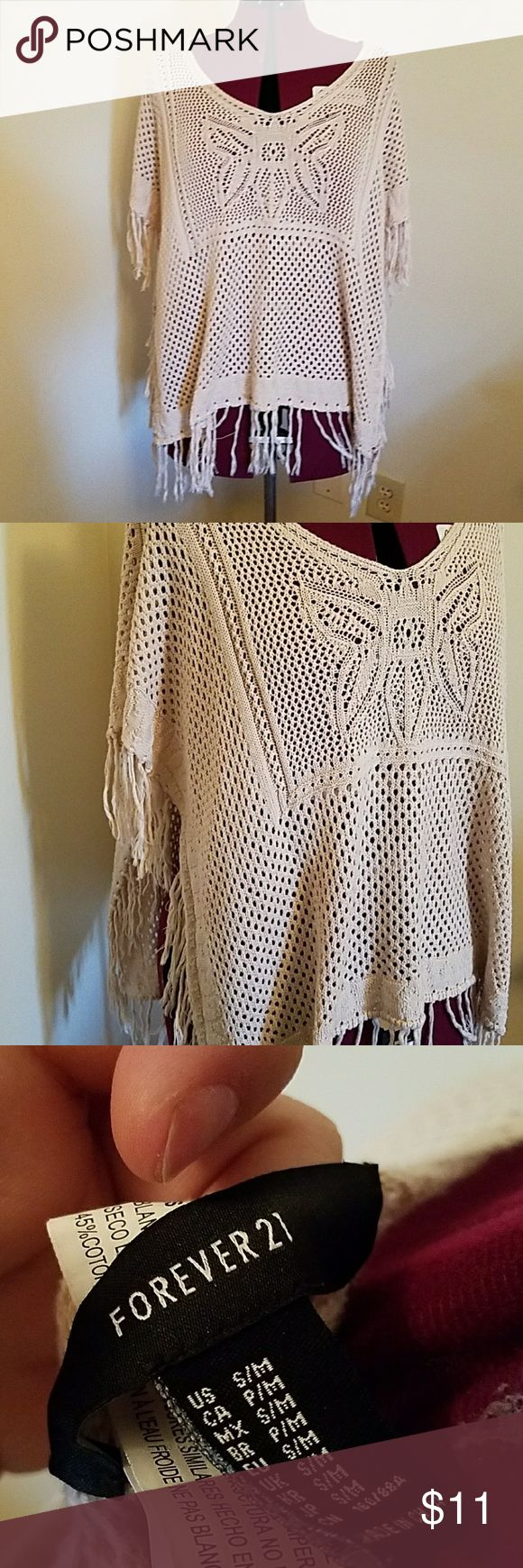 Beige Crochet Poncho Lightly worn and still in great condition. This beige poncho is great for all seasons. Because it is so lightweight you can either wear it over a tank top use it to layer or even wear it over a bathing suit or bandeau. Size small/medium. Has fringe on the bottom. 55% acrylic and 45% cotton. Forever 21 Sweaters Shrugs & Ponchos