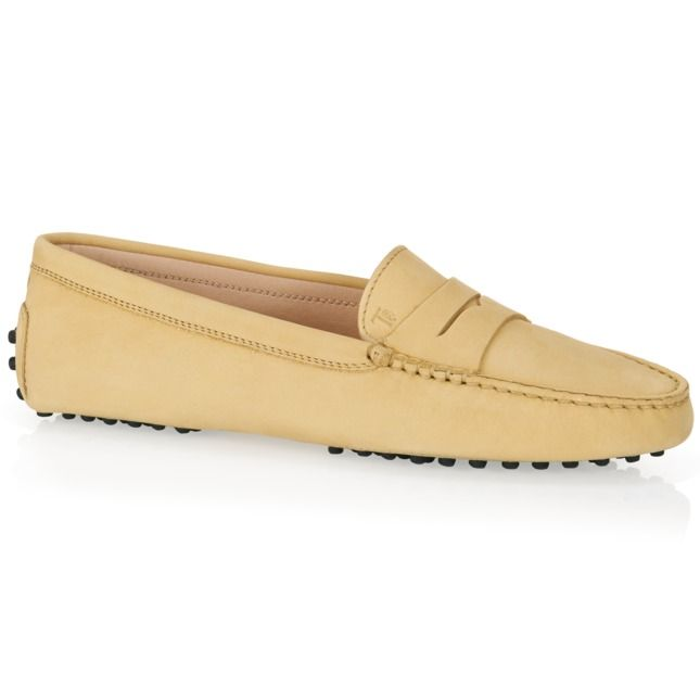 Tod's Gommino driving shoes in velvety and soft nubuck worked according to a unique artisan technique which accents its natural softness, available in a wide range of colors, with exposed hand-made stitching, penny bar, hot-stamped monogram and iconic rubber pebble outsole.