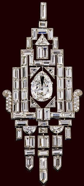 An art deco diamond pendant circa 1930 of flexible openwork design centering an