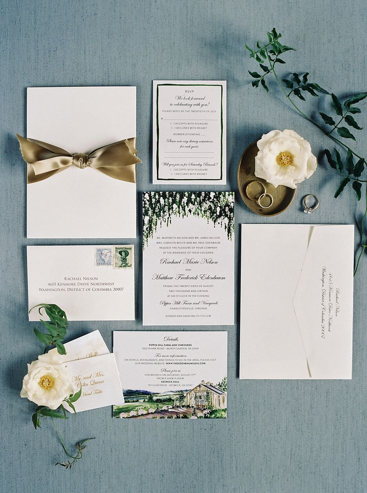 White and floral wedding invitations at Pippin Hill Farm & Vineyards | Photographer: Laura Gordon