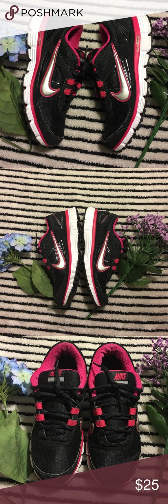Nike dual fusion sneakers Nike dual fusion tennis shoes fuchsia and black color •.normal wear •  size 8 1/2 • Nike Shoes Sneakers
