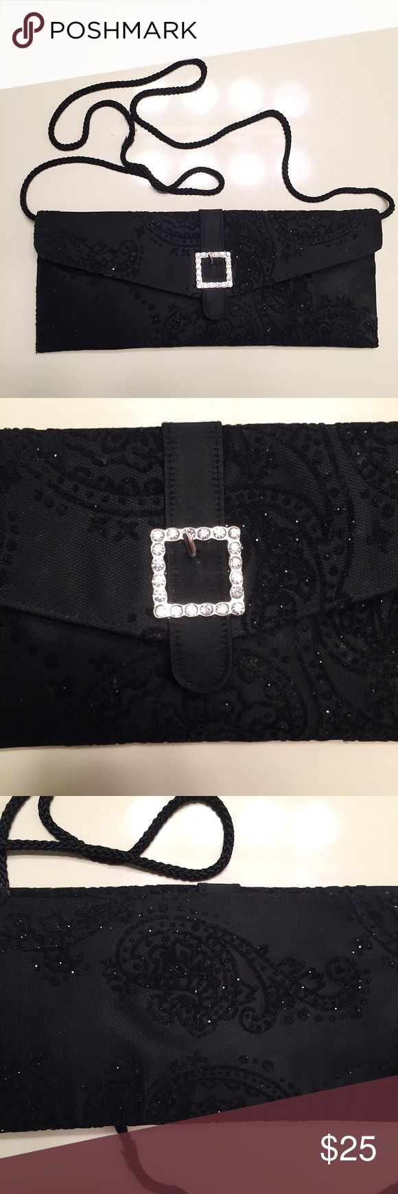 Black sparkly clutch with mirror Black slightly sparkly clutch purse wth attached mirror inside (as shown in pics). It has been used a few times but is in good condition. Great for a fancy occasion like a nice dinner or prom dance. Metaphor Bags Crossbody Bags