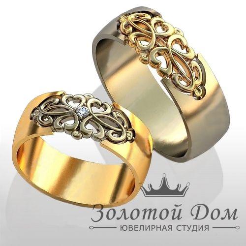 Обручальные кольца с бриллиантом.