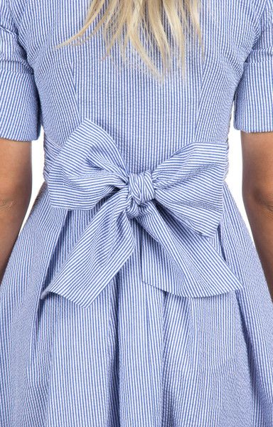 Preppy AND classic, this dress has a little something for everyone. Styled from the iconic button-down shirt, the Taylor embodies a classic look with a full, flirty skirt! With adjustable sleeves, a s