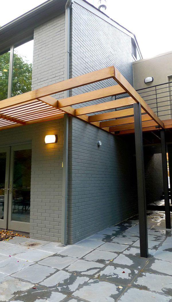 Modern pergola for over the garage door.