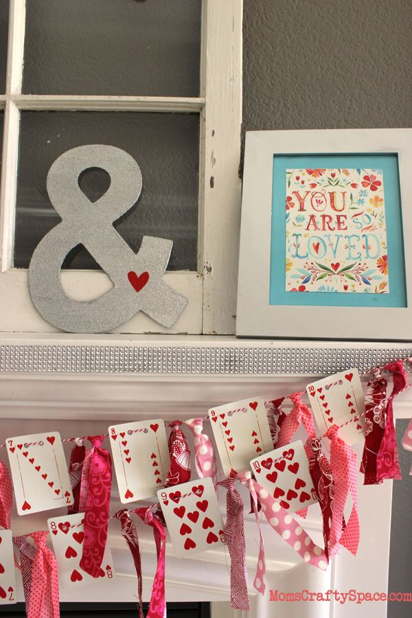 Valentine's Day Heart Cards Garland - quick, easy and totally adorable  holiday decoration via Happiness is Homemade