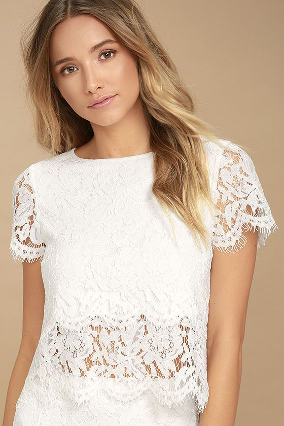 The Heartbeats White Lace Crop Top has earned our adoration forever on! Eyelash lace forms this adorable crop top with a rounded neckline and short sleeves. Even more lace drops below the scalloped hem to create a sheer, tiered look. Back keyhole with top button.