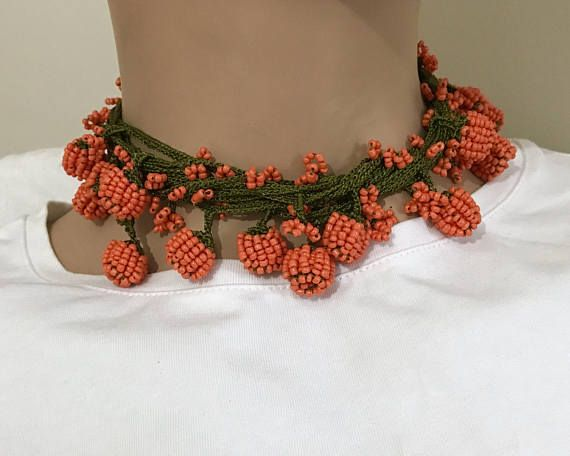 Orange turkish oya necklace in green with orange beads. It is handmade. If desired, it can be used as necklace, belt, decoration. Lenght is 4 meters ( 157 inches) . If the length is too long, you can shorten it with the fire. you can also ask for different colors. It is a very nice work