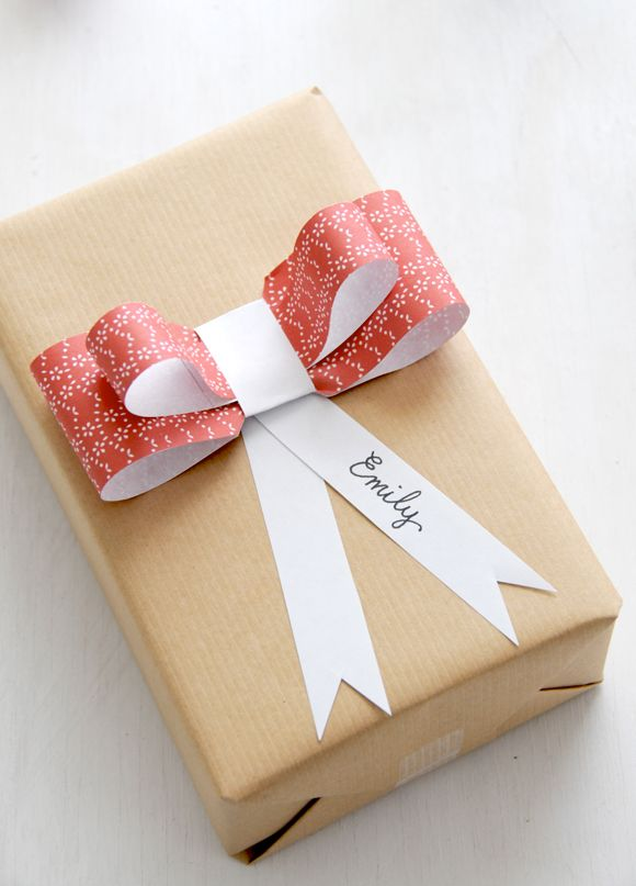 Make way for paper ribbon. Doubles as name tag and bow.