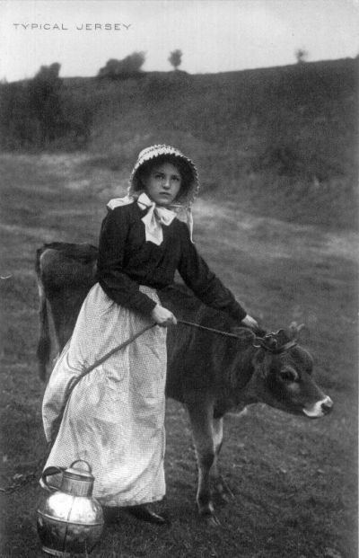 Old photo, girl with jersey calf.